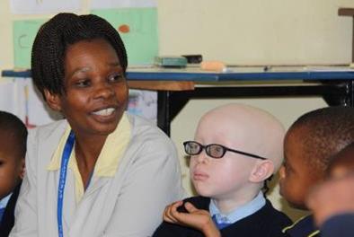 St Jude's Lower Primary Teacher Martha Dello with Sebastian in the classroom.